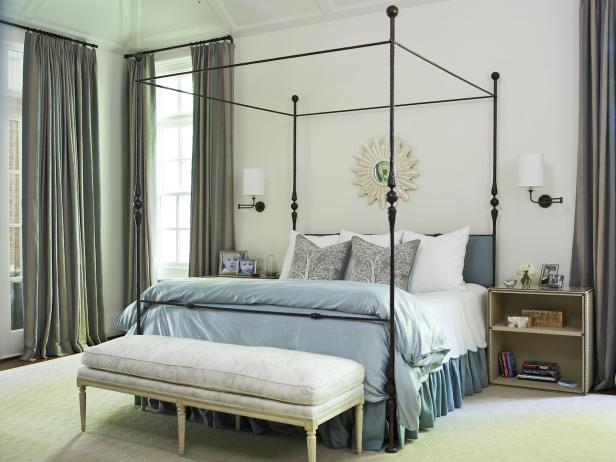 interesting Interior Bedroom with Metal Canopy Bed Between Wall Lamps above Shelves