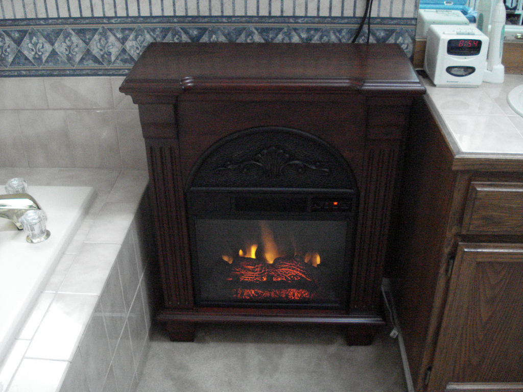 Superbe Adorable Design Of The Brown Oak Wooden Materials Of The Small Electric  Fireplace At The Corner