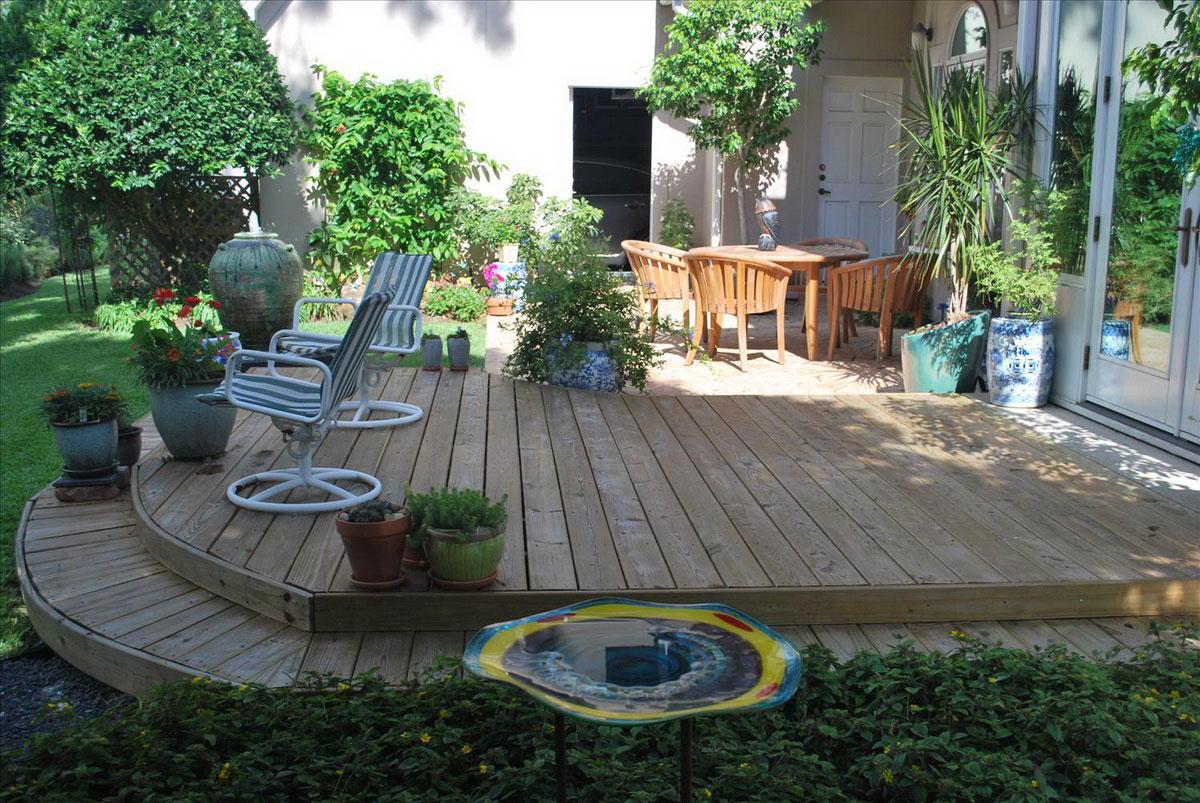 Amazing Design Of The Backyard Design Ideas With Brown Wooden Floor Ideas Added With Grey Rattan Seats Ideas