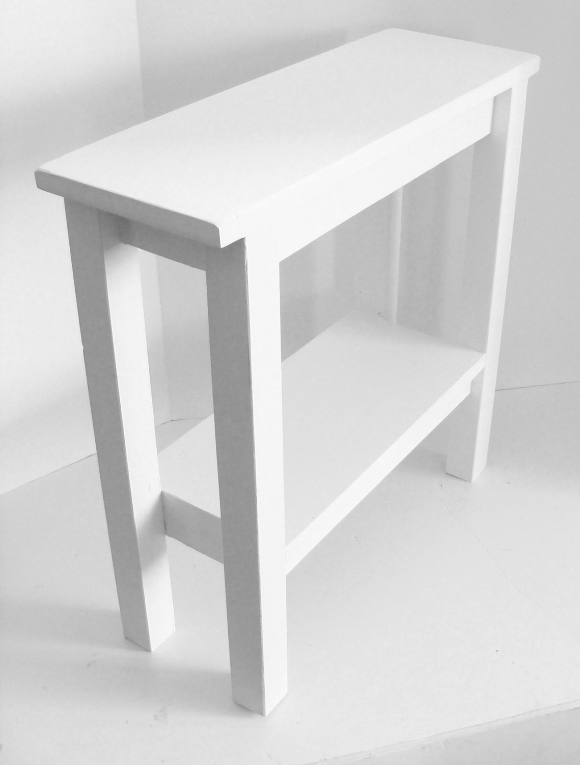 Amazing Design Of The White Wooden Small Side Table Ideas With White Wooden Shelves And White Wall Ideas