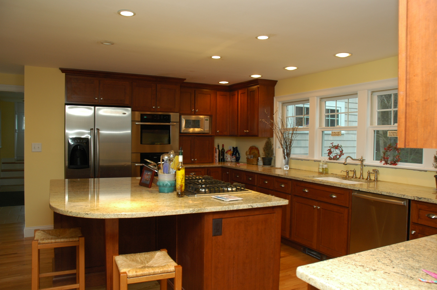 Appealing Design Of The Kitchen Areas With Brown Wooden Kitchen Island Design With Kitchen Cabinets