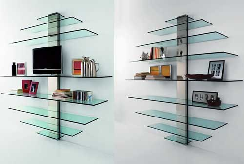 Astonishing Design Of The Glass Wall Shelves With Rounded Shape Put At The White Wall With Silver Iron Holder