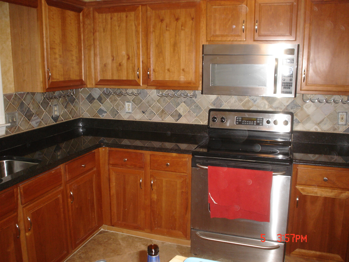 Beau Astonishng Design Of The Brown Wooden Cabinets Added With Grey Tile  Backsplash Ideas With Black Marble