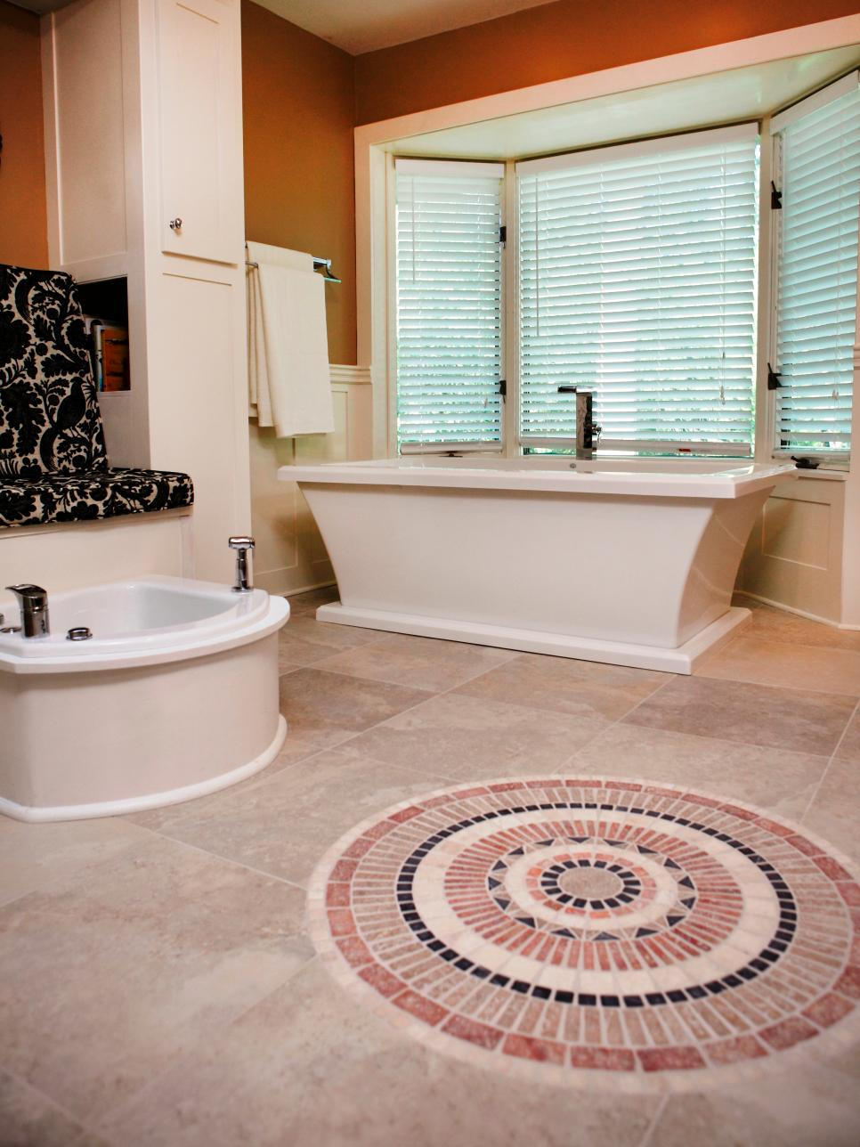 Astounding Design Of The Bathroom Areas Wth Orange Wall Added With Whtie  Tubs And Big Mirror. Gravel Bathroom Floor Idea