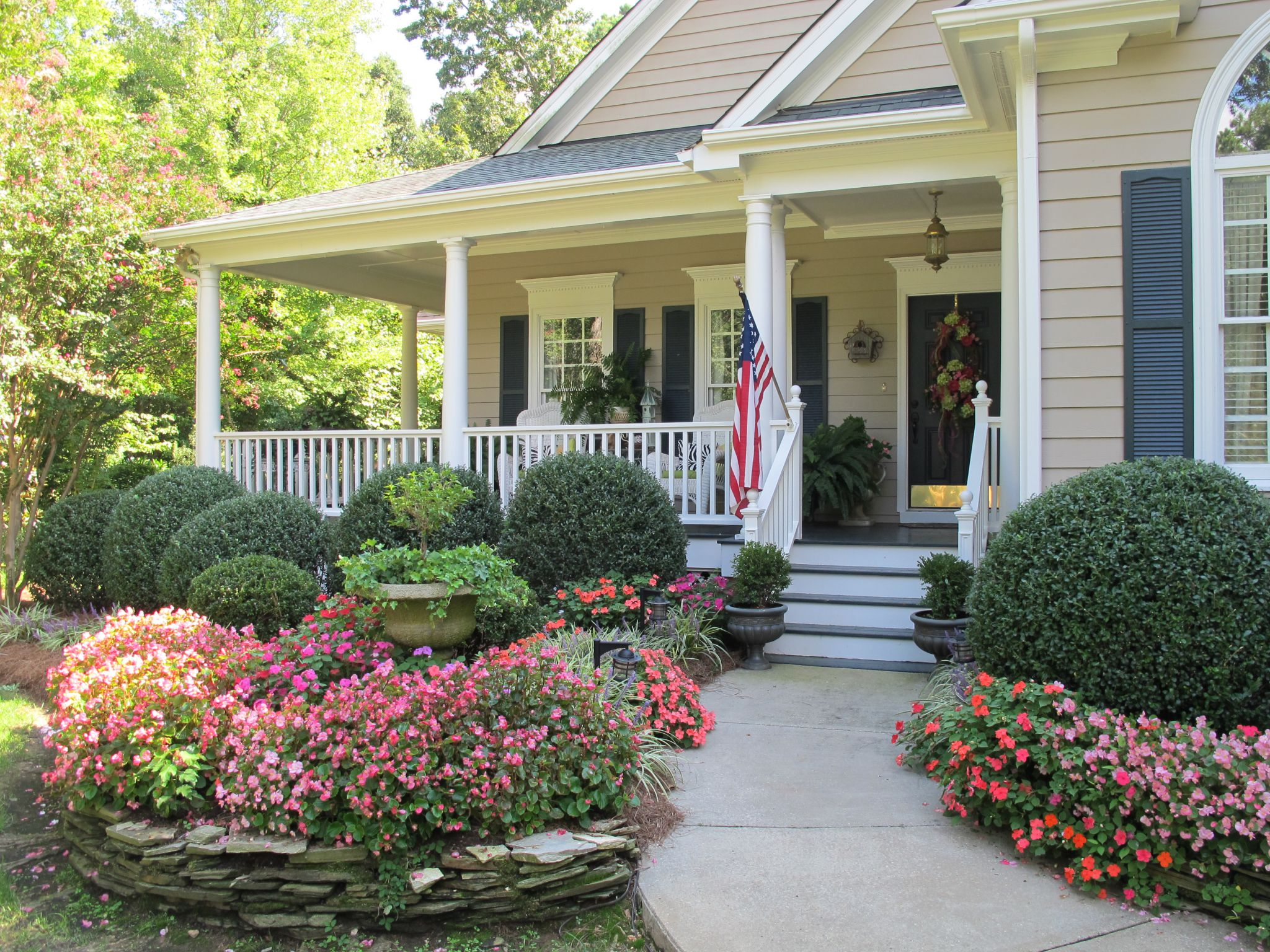 Astounding Design Of The Flower Bed Ideas With Green Grass Areas Added With Gray Road As The Curb Appeal Ideas