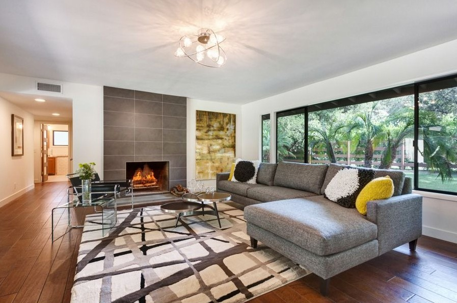 Attractive Living Space Decor Using Lush Chandelier also Gray Sofa