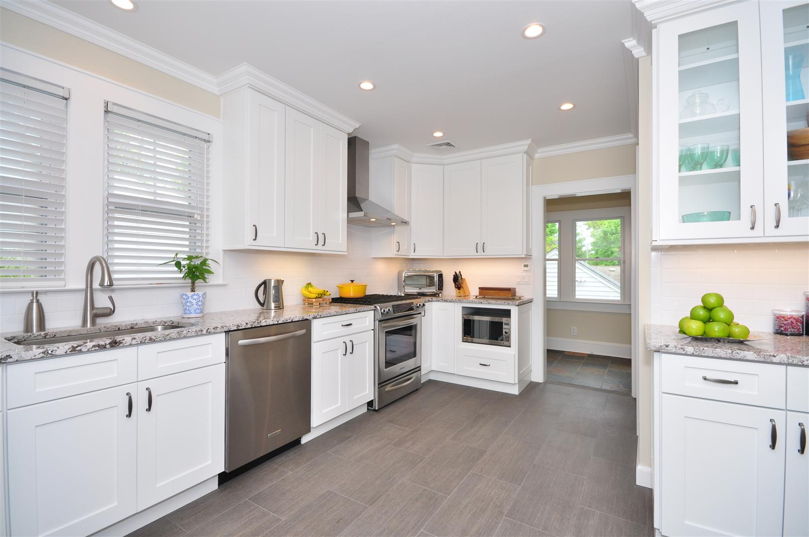 Complete Spacious Kitchens with White Cabinets and Grey Marble Countertop under White Painted Wall