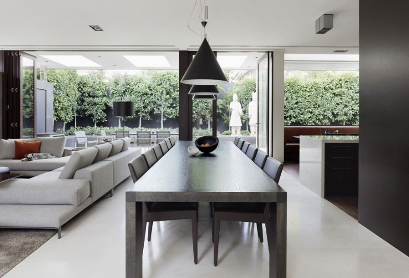 Contemporary Dining Space Using Wooden Table And Dark Chairs Decor