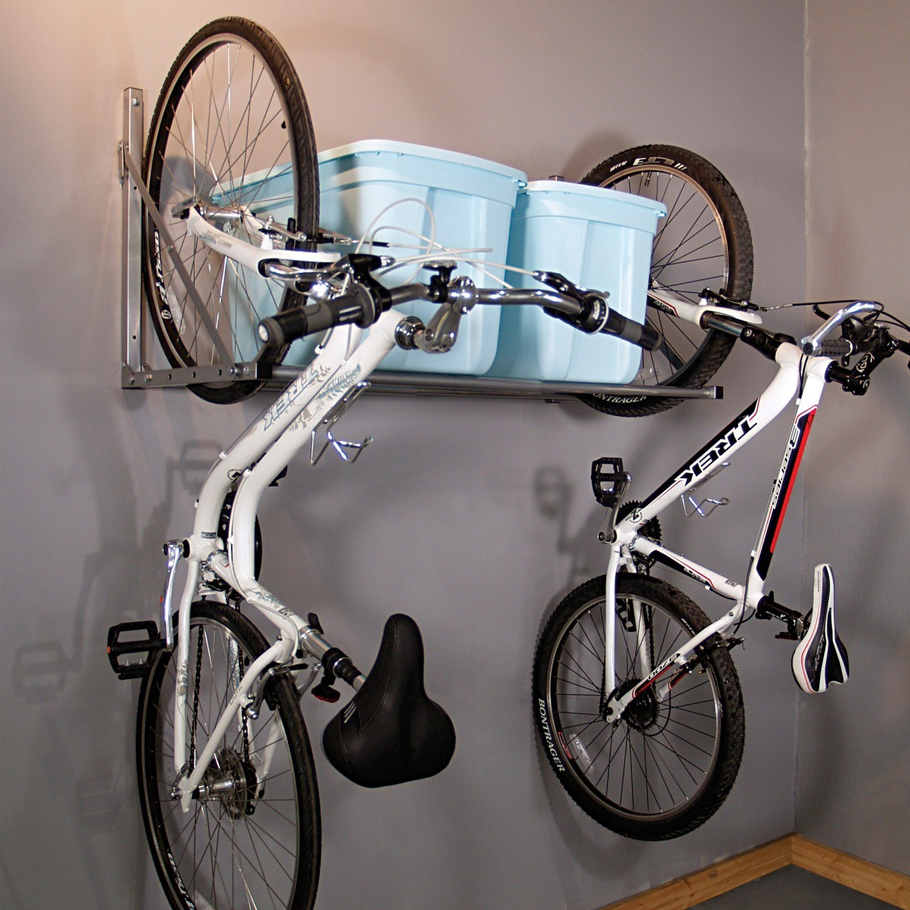 Elegant Deisgn Of The Garage Bike Storage With Black Iron Hanger For The Bikes Put On The Grey Wall Ideas