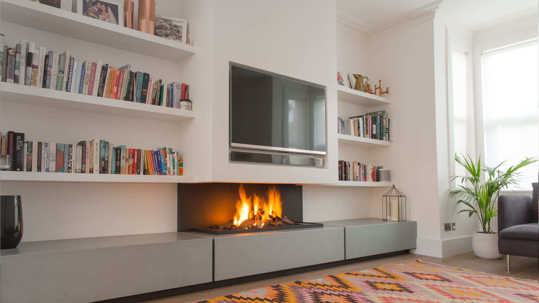 Elegant Design Of The White Wall Added With White Shelves And Modern Gas Fireplace Ideas