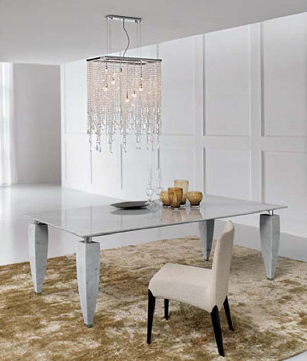 Excellent dining Space Using Glass Table Under Cute Chandelier Decor
