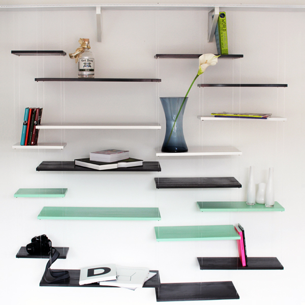 Fantastic Design Of The Glass Wall Shelves With So Many Shelvs Put At The White Wall With So Many Stuffs On It