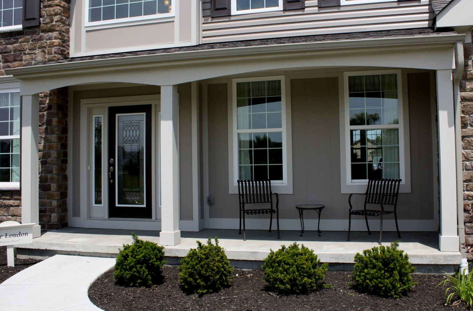 Fantastic Design Of The Grey Wall Ideas With Black Iron Chairs As The Front Porch Designs