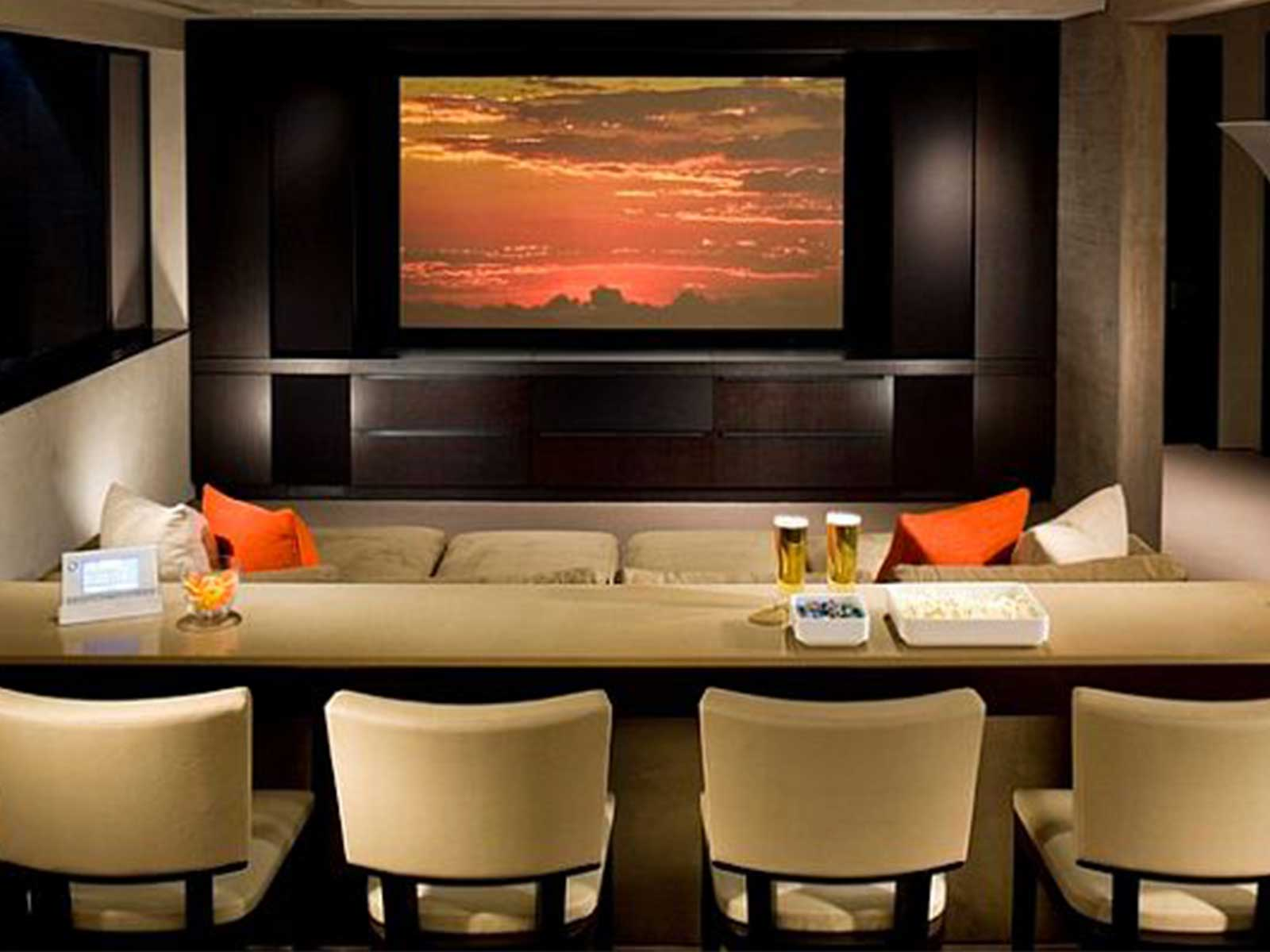 Fantastic Design Of The White Wall And Big Screen Of The Home Theater Design With Some Fabric Chairs