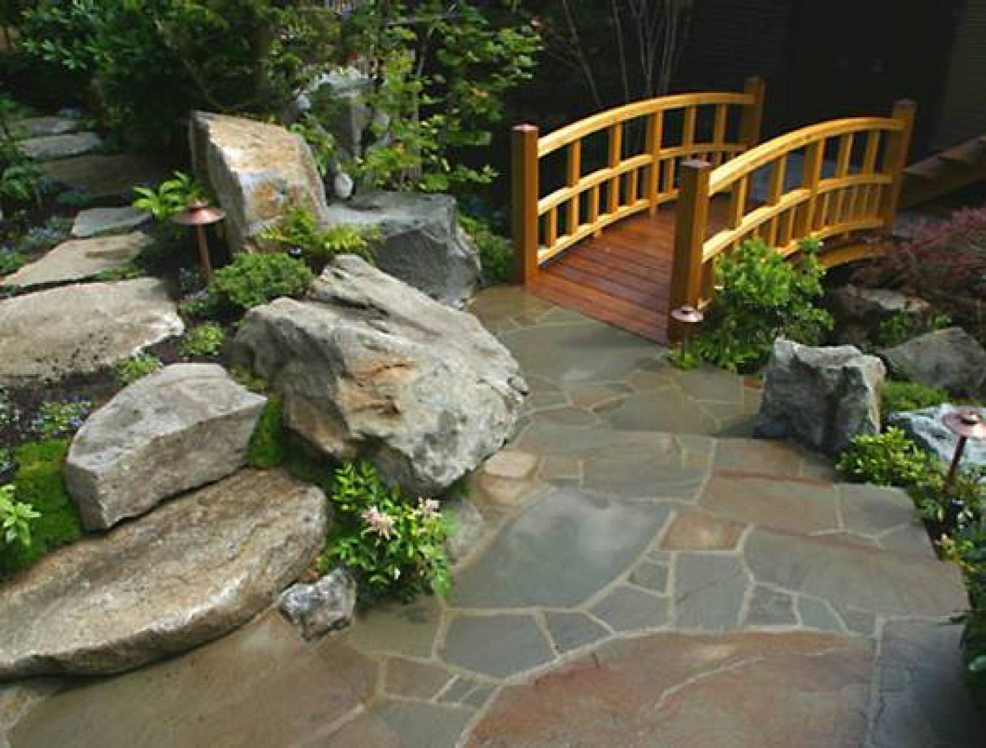 Fantastic Japanese Backyard Garden Design Idea with Wooden Bridge also Concrete Floor plus Rock