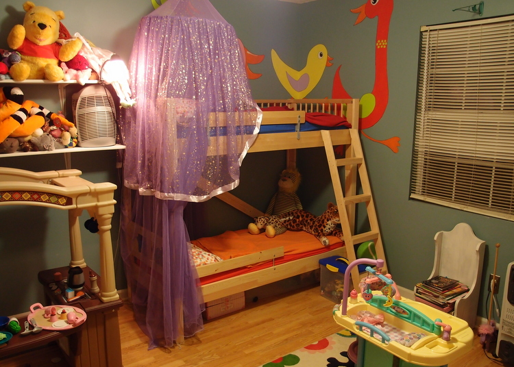 Fascinating Wooden Bunk Bed Using Purple Mosquito Net and Shelve
