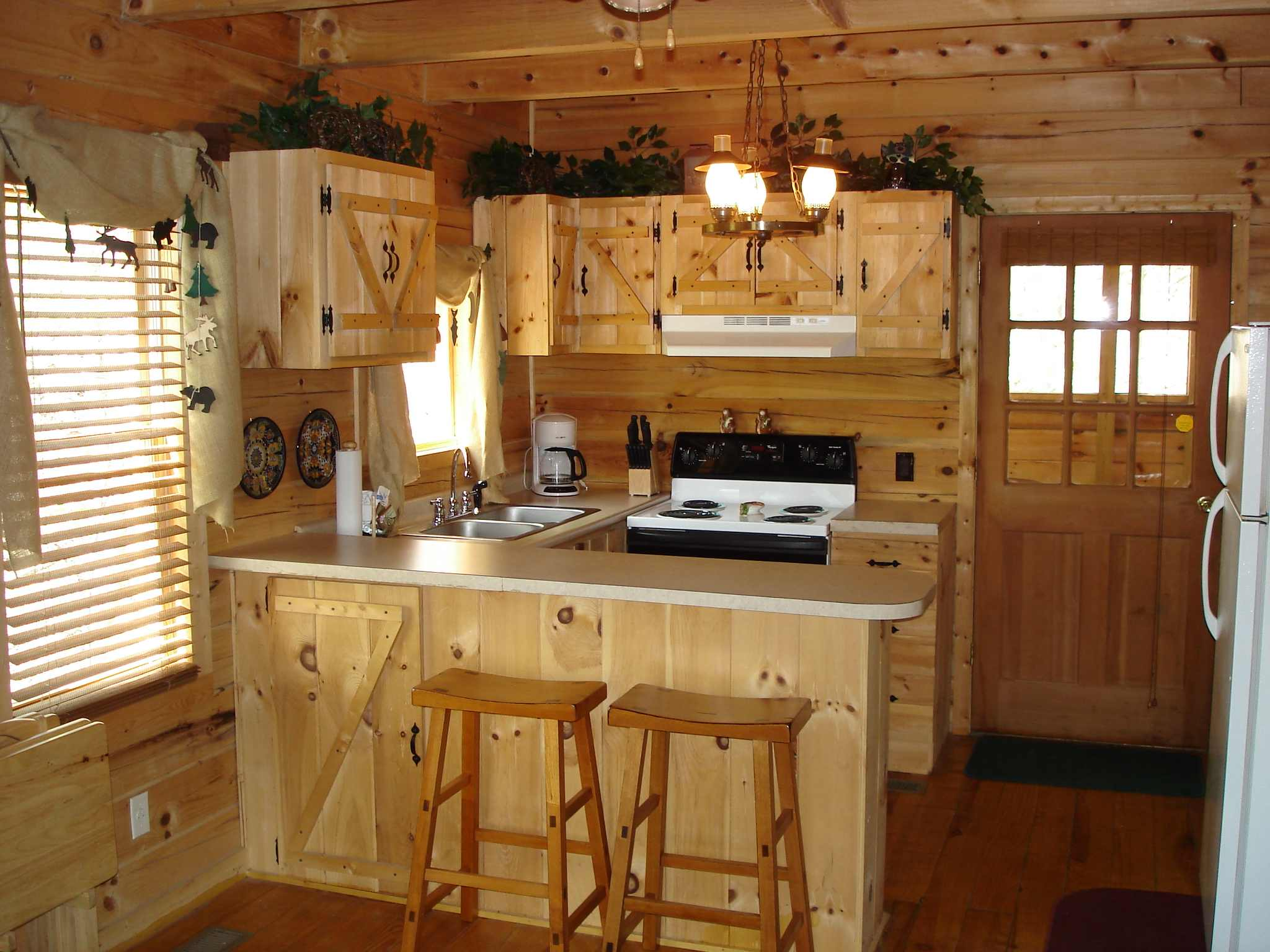 Amazing Impressive Interior For Small Kitchen Using Wooden Cabinet And Bar Chair  Decor