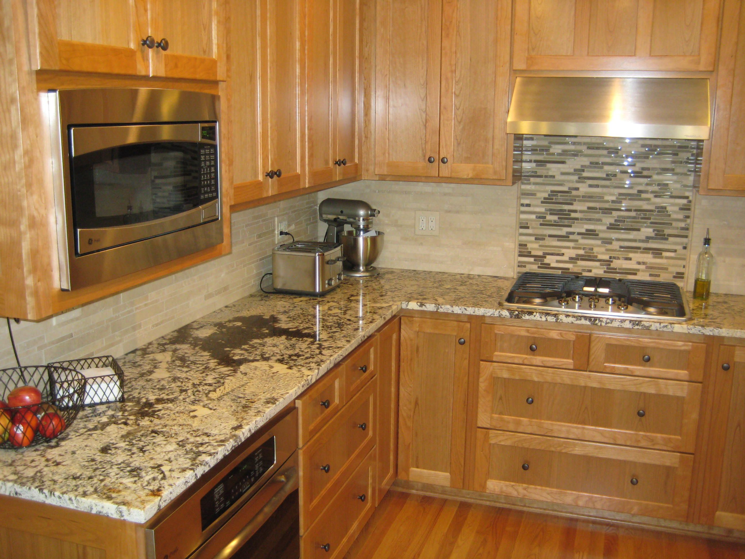 Lovely Design Of The Brown Wooden Cabinets Added With Grey Marble Tops And Grey Tile Backsplash Ideas