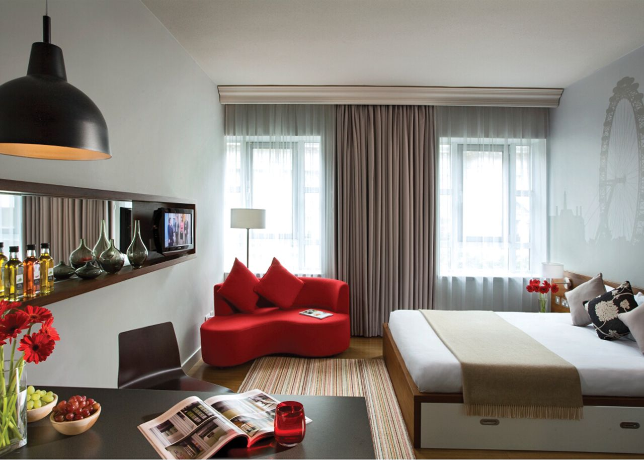 Lovely Design Of The White Wall Added With Grey Curtain And Red Cough Ideas As The Small Apartment Furniture Ideas