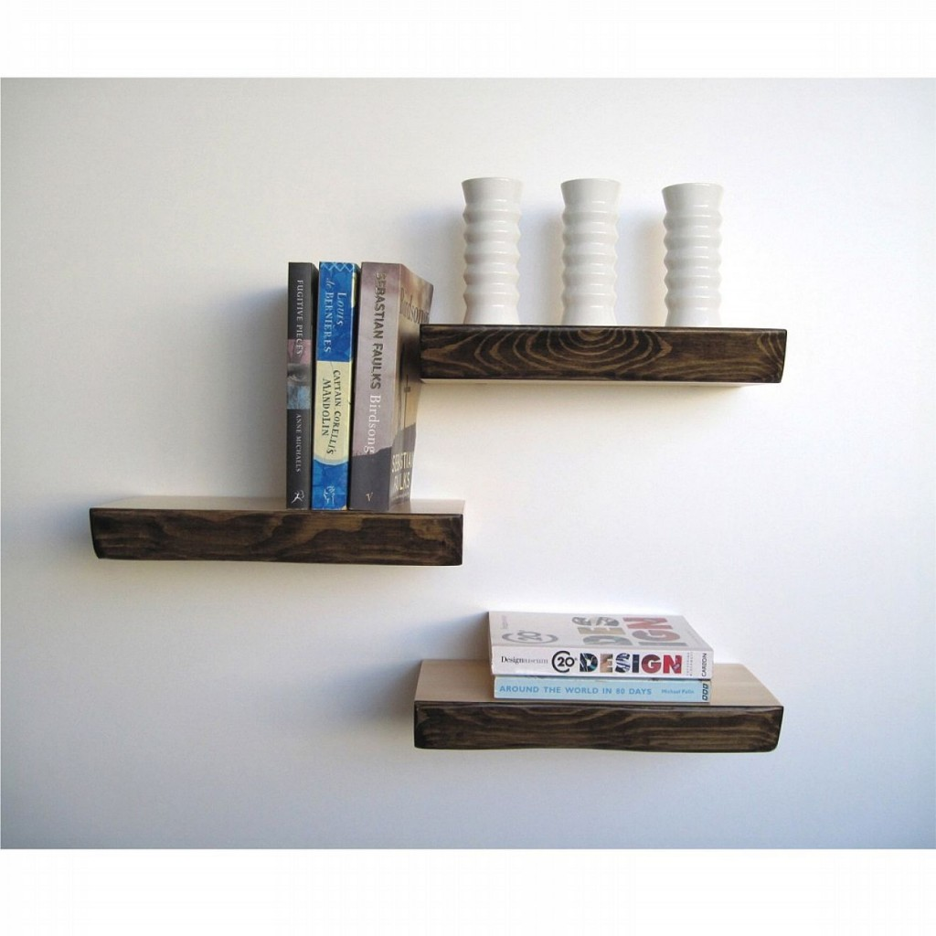 Lovely Design Of The White Wall Ideas Added With Black Wooden Floating Shelves Design With Some Books