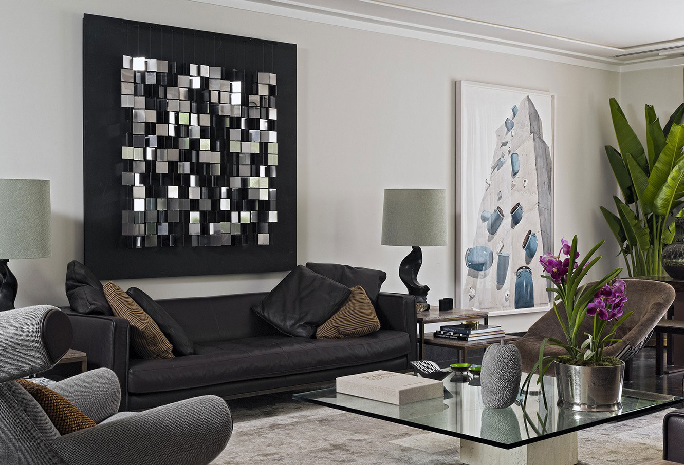 Lovely Wall Decor above Black Sofa plus Glass Coffee Table