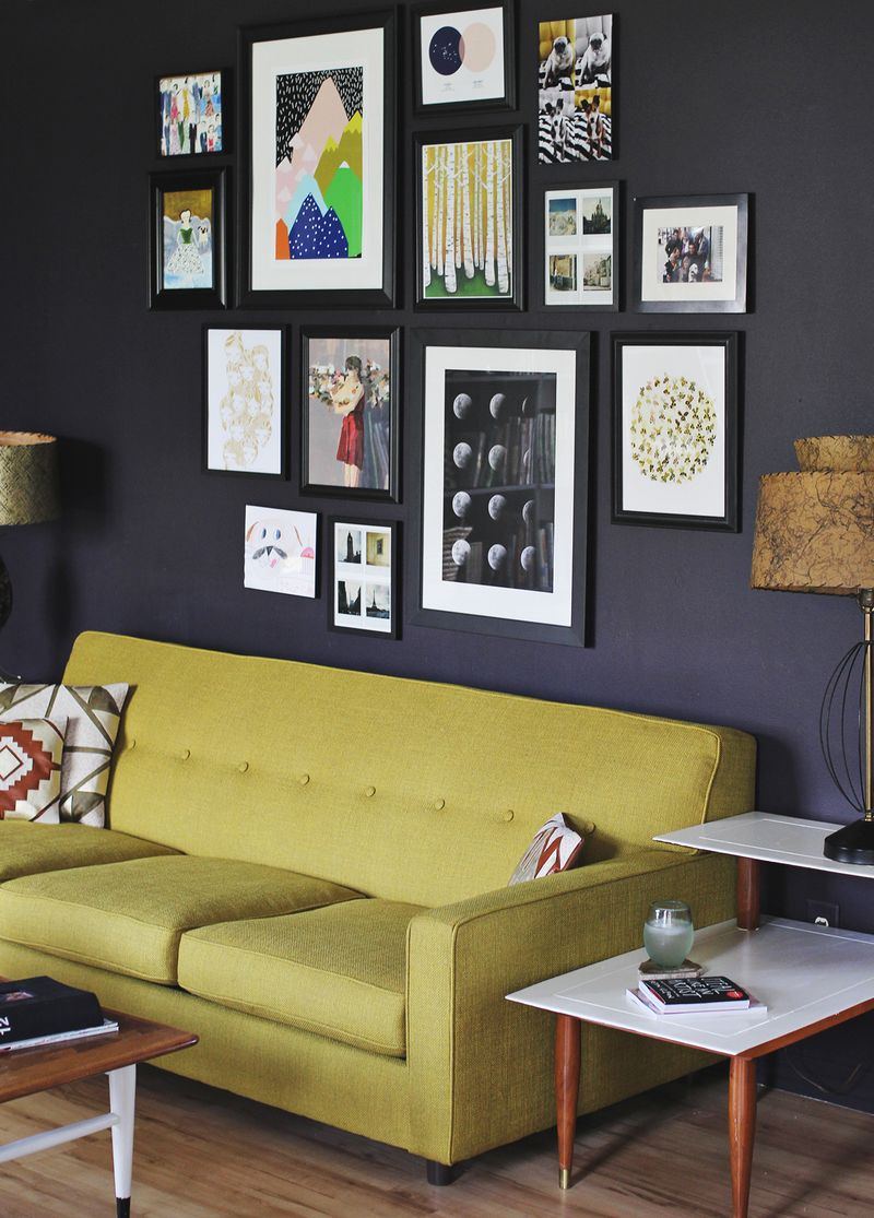 Marvelous Design Of The Black Wall Ideas With Picture Hanging Ideas Added With Green Sofa Added With Brown Side Table Ideas