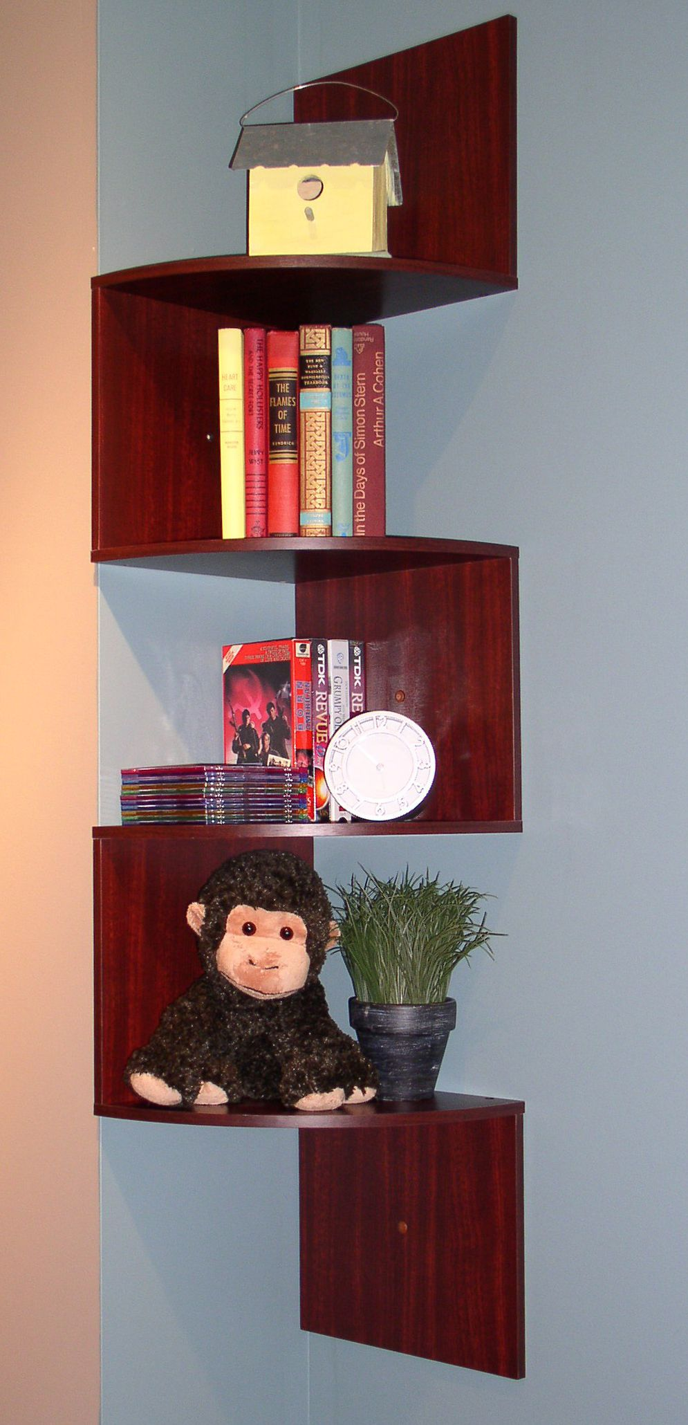 Marvelous Design Of The Blue Wall Added With Brown Wooden Shelves Corner Ideas With Some Books Ideas