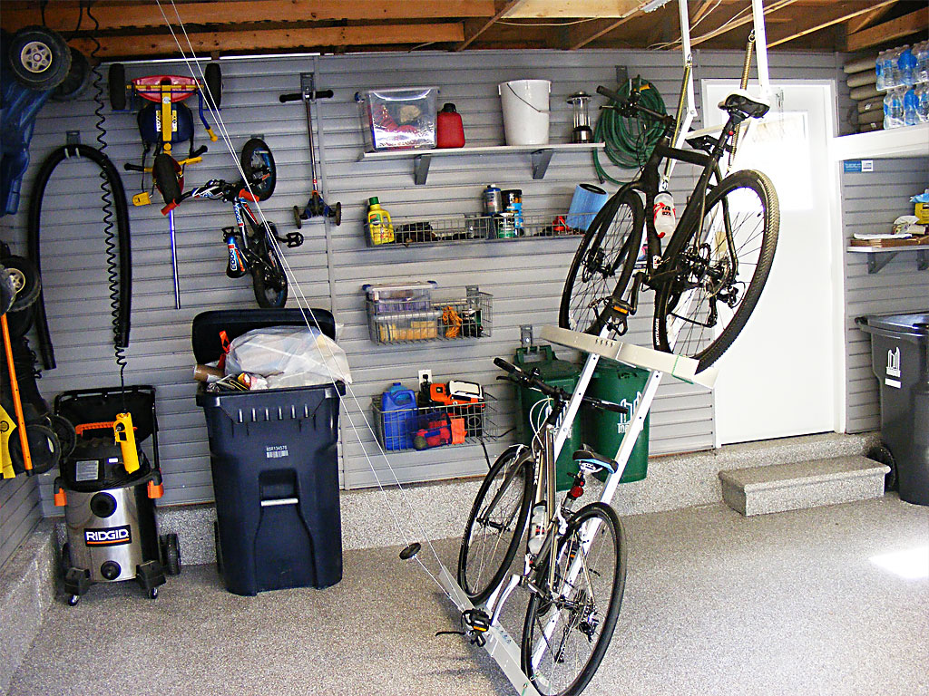 Marvelous Design Of The Garage Bike Storage With Grey Wall Added With White Floor And Creative Hanger For The Bike Ideas