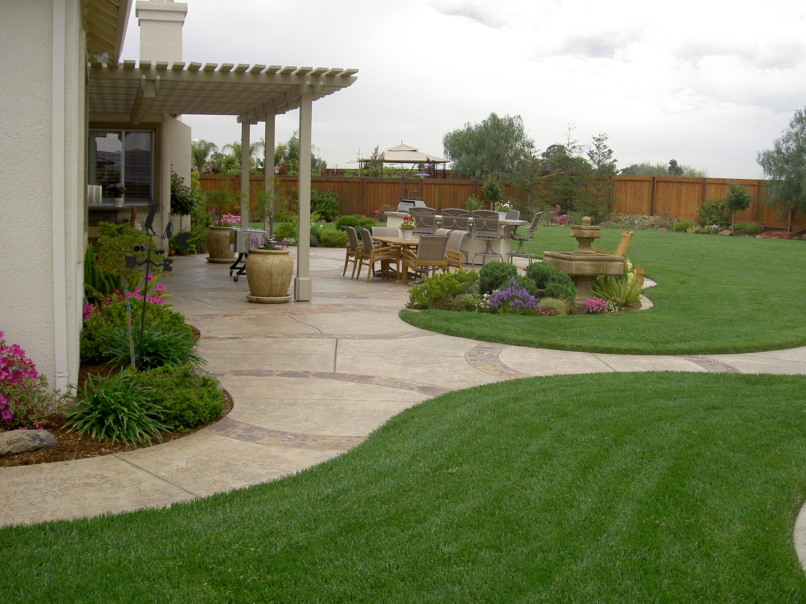 Marvelous Design Of The Green Grass At The Open Wide Areas With Grey Tile Floor As The Landscape Backyard Ideas