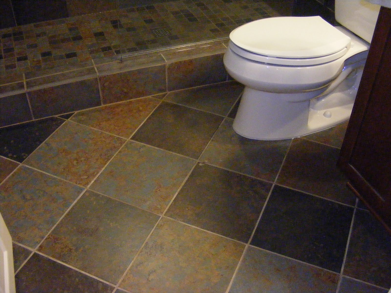 Marvelous Design Of The Grey Tile Floor Ideas Added With White Toilets And Brown Wooden Cabinets Ideas