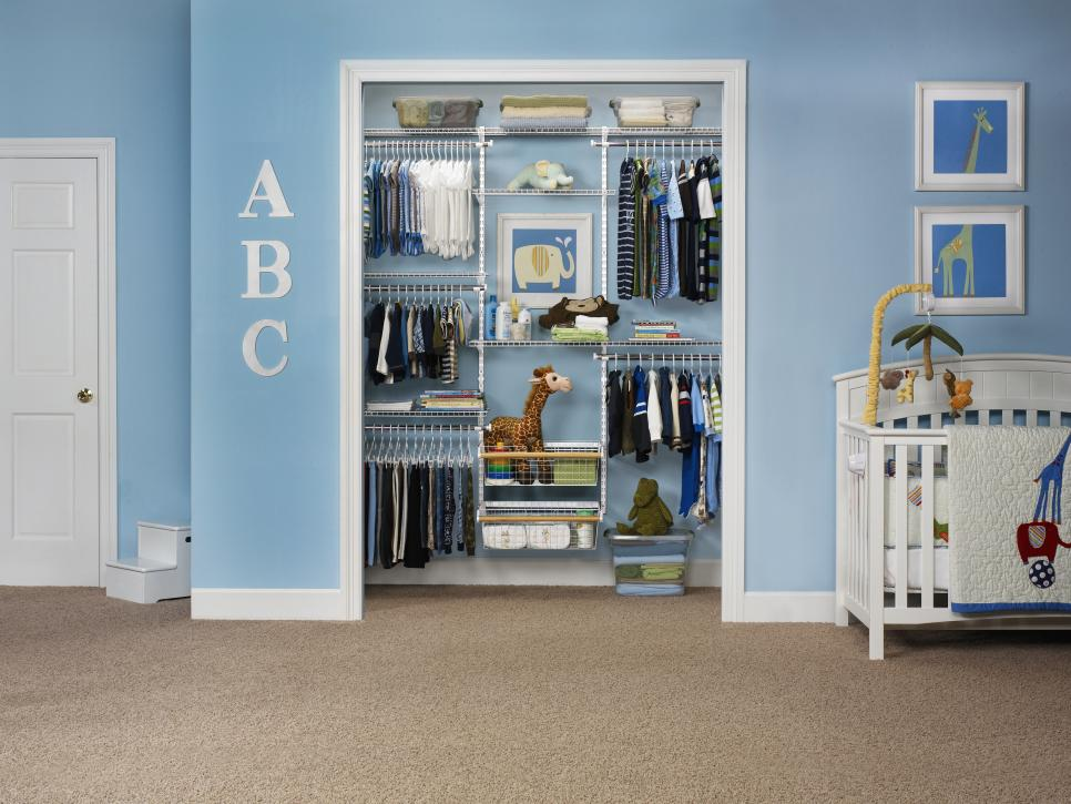 Marvelous Nursery Room With White Crib Beside Clothes Storage Ideas