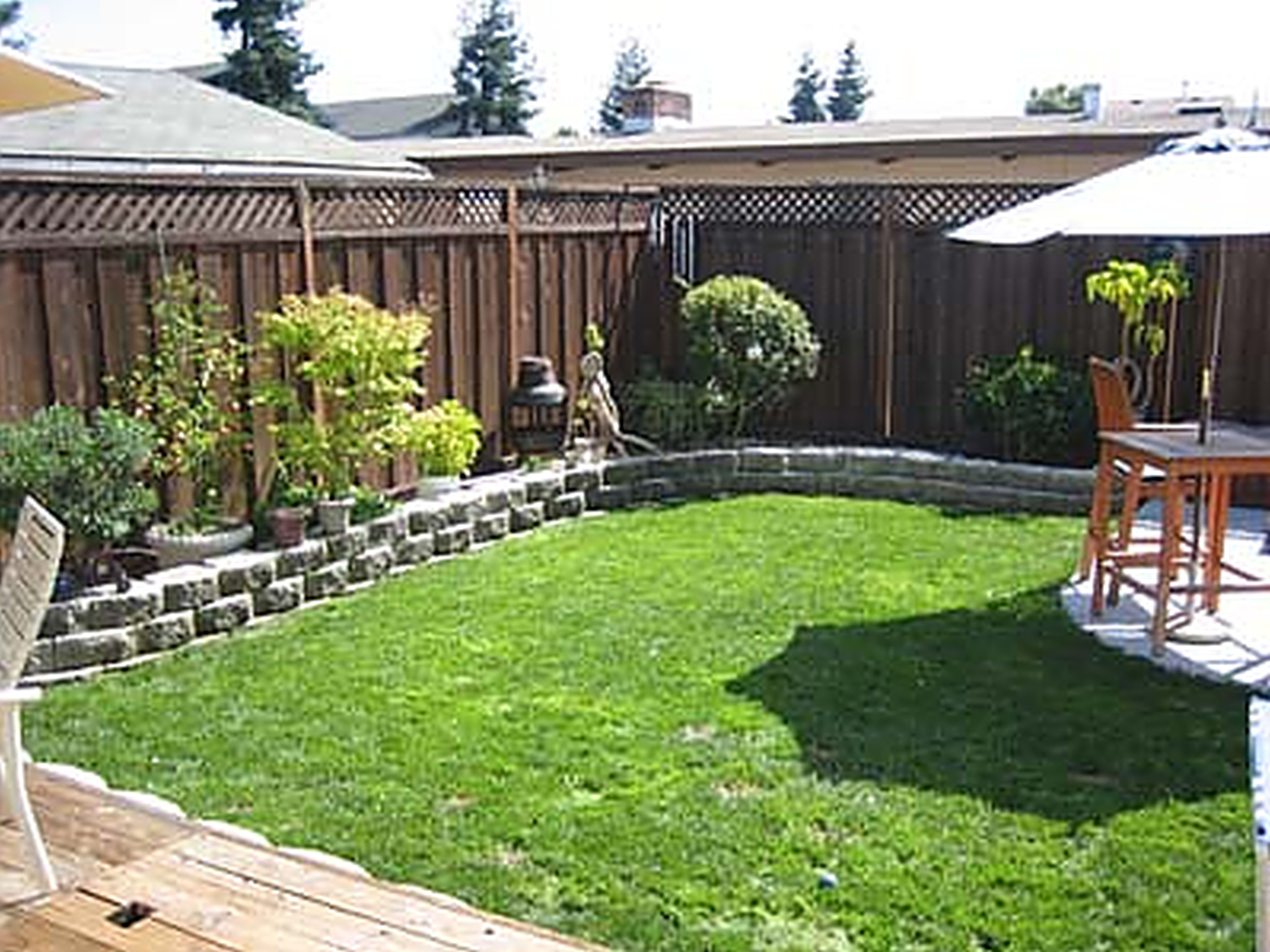 marvelous wood fence right for diy backyard ideas with square table under umbrella diy backyard landscaping
