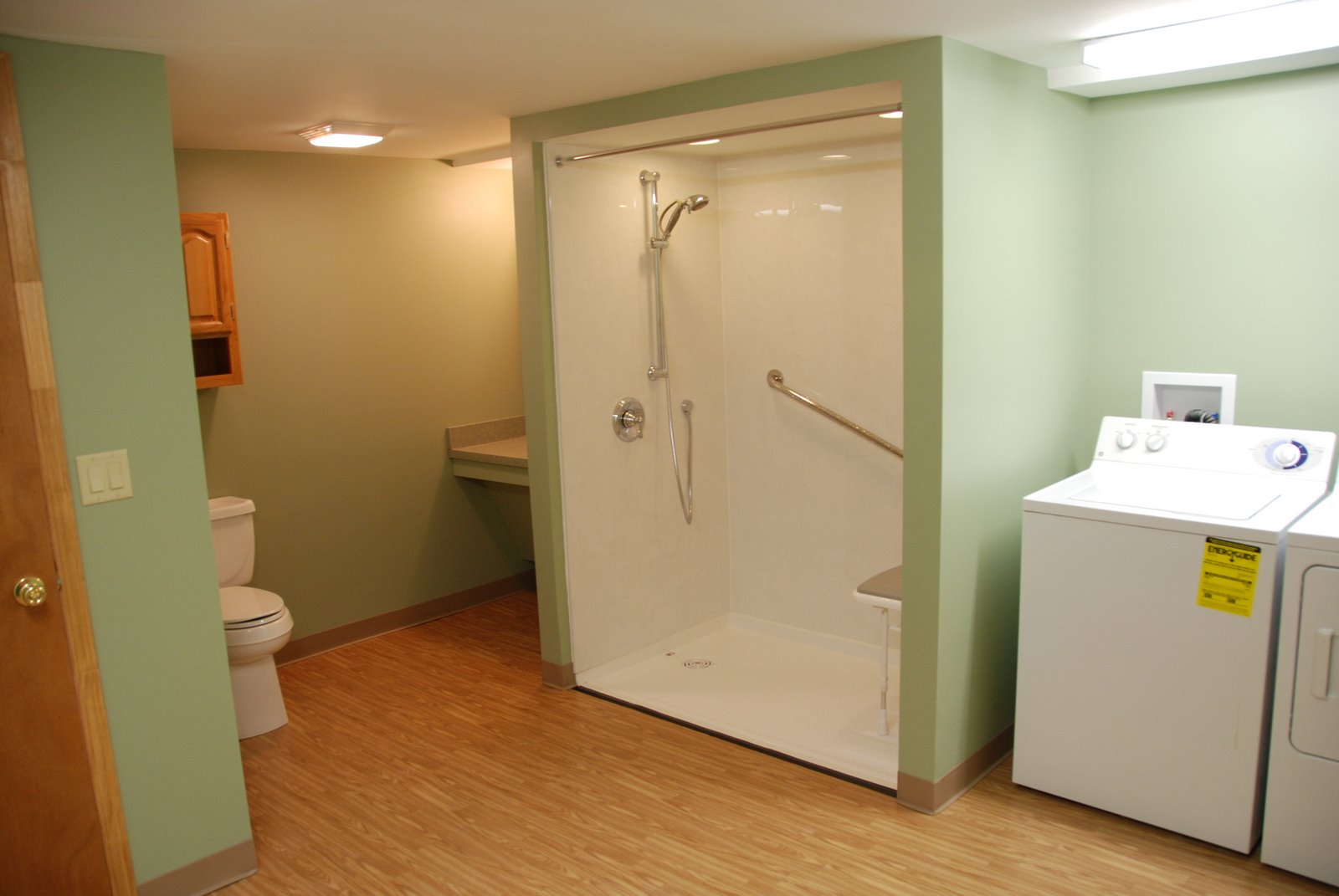 Neat Basement Bathroom Ideas With Showering Area Near Washing Machine