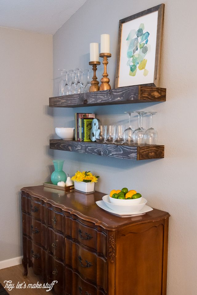 Radiant Wooden Cabinet also Floating Shelve Plus Glass and Candle