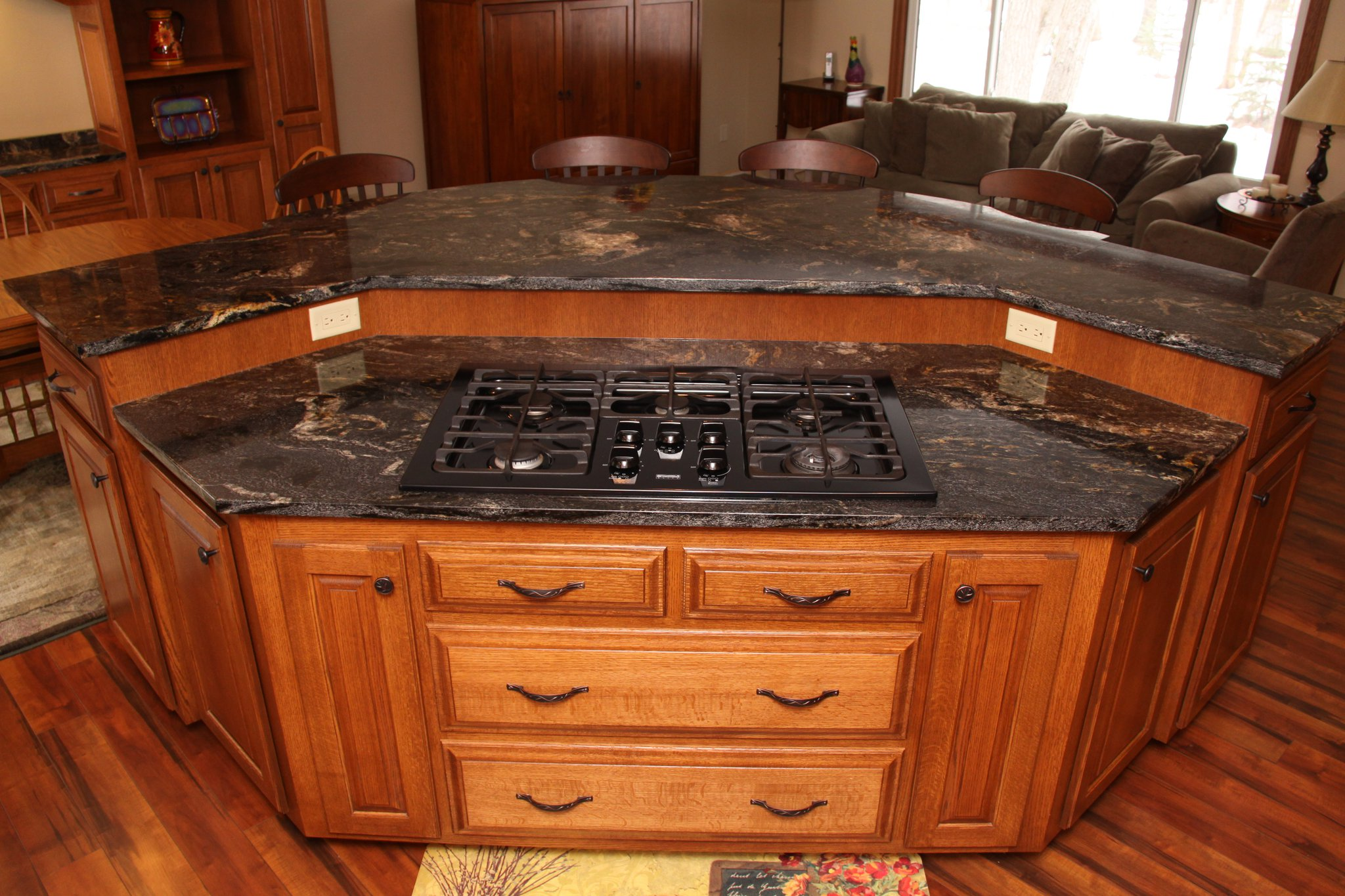 Remarkable Design Of The Brown Wooden Floor Added With Black Marble Tops Ideas With Stove Ideas