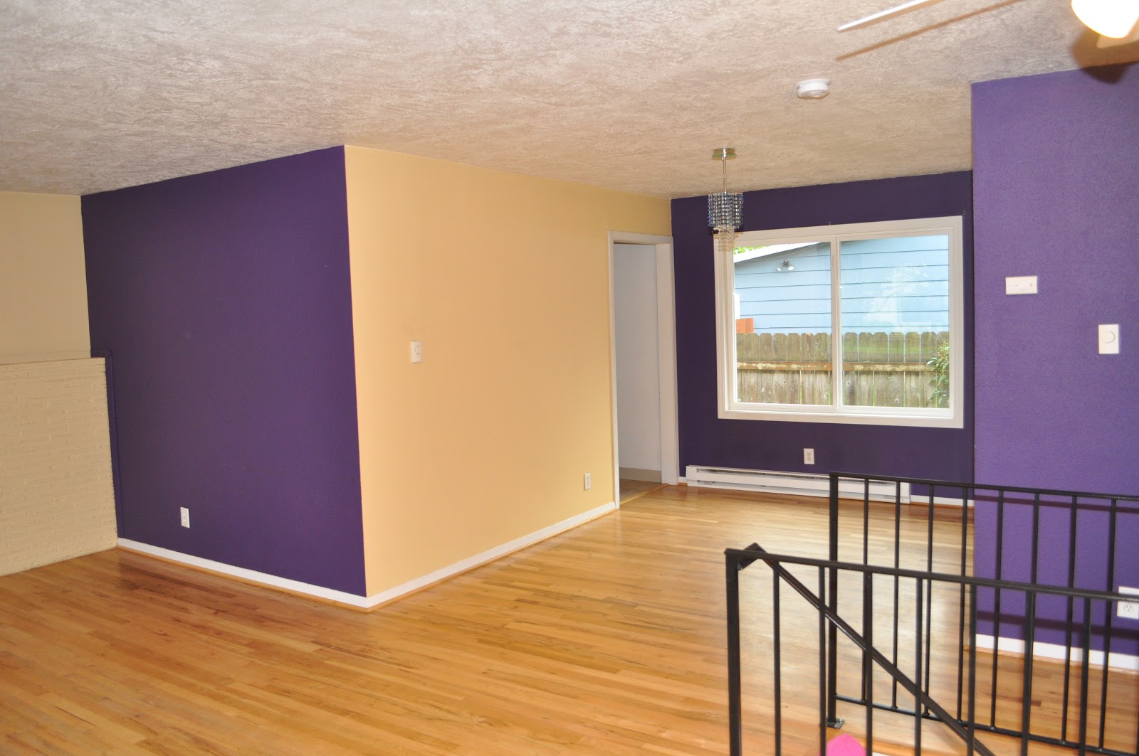Remarkable Design Of The Living Room Areas With Brown Wooden Floor Added With Purple And Beige Wall Paint Ideas