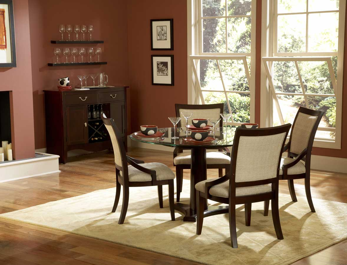 Small Dining Room Decorating Ideas with Round Glass Top Table and Comfy Chairs on Grey Carpet