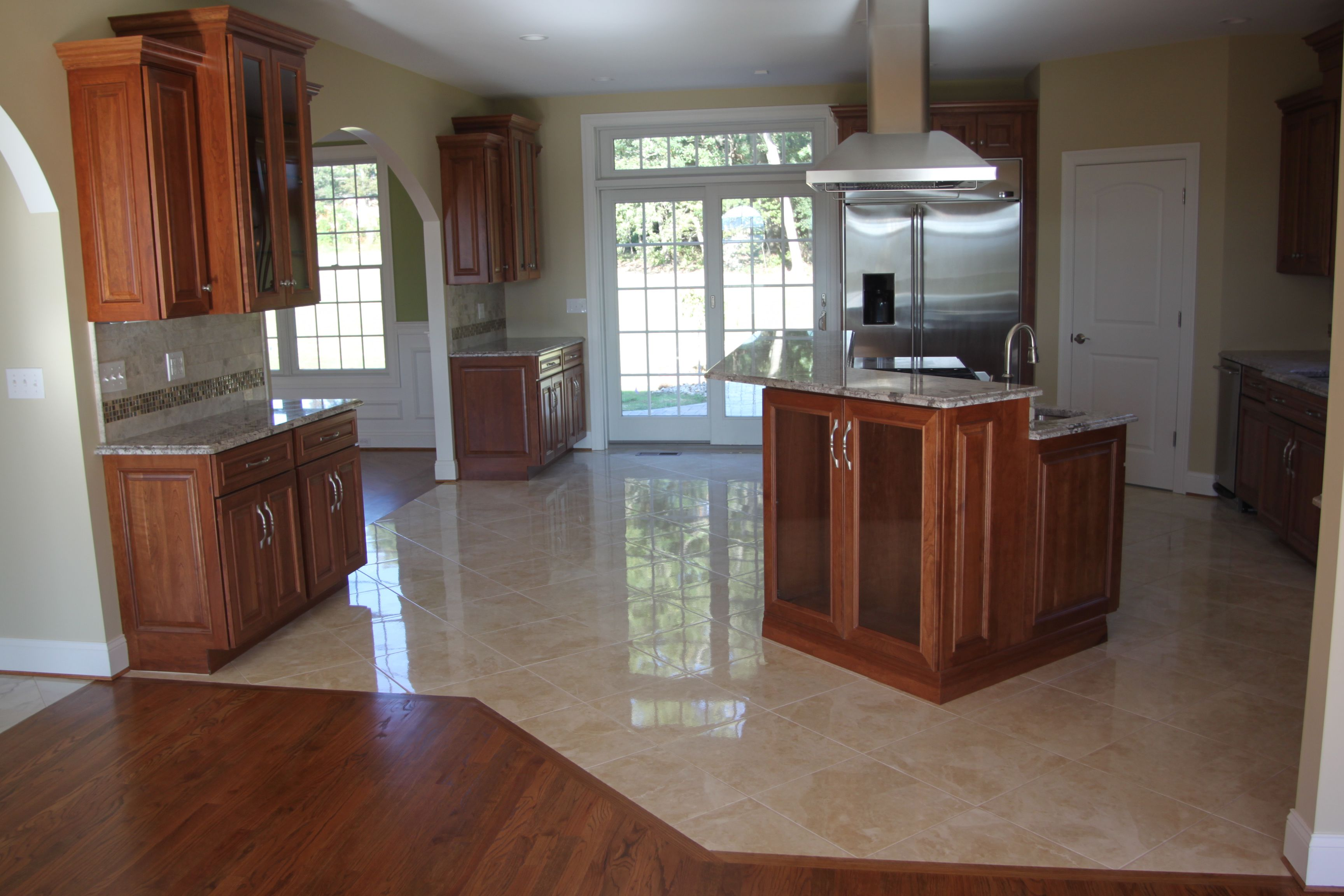 Spacious Kitchen With Granite Floor Tile also Brown Wooden Cabinet