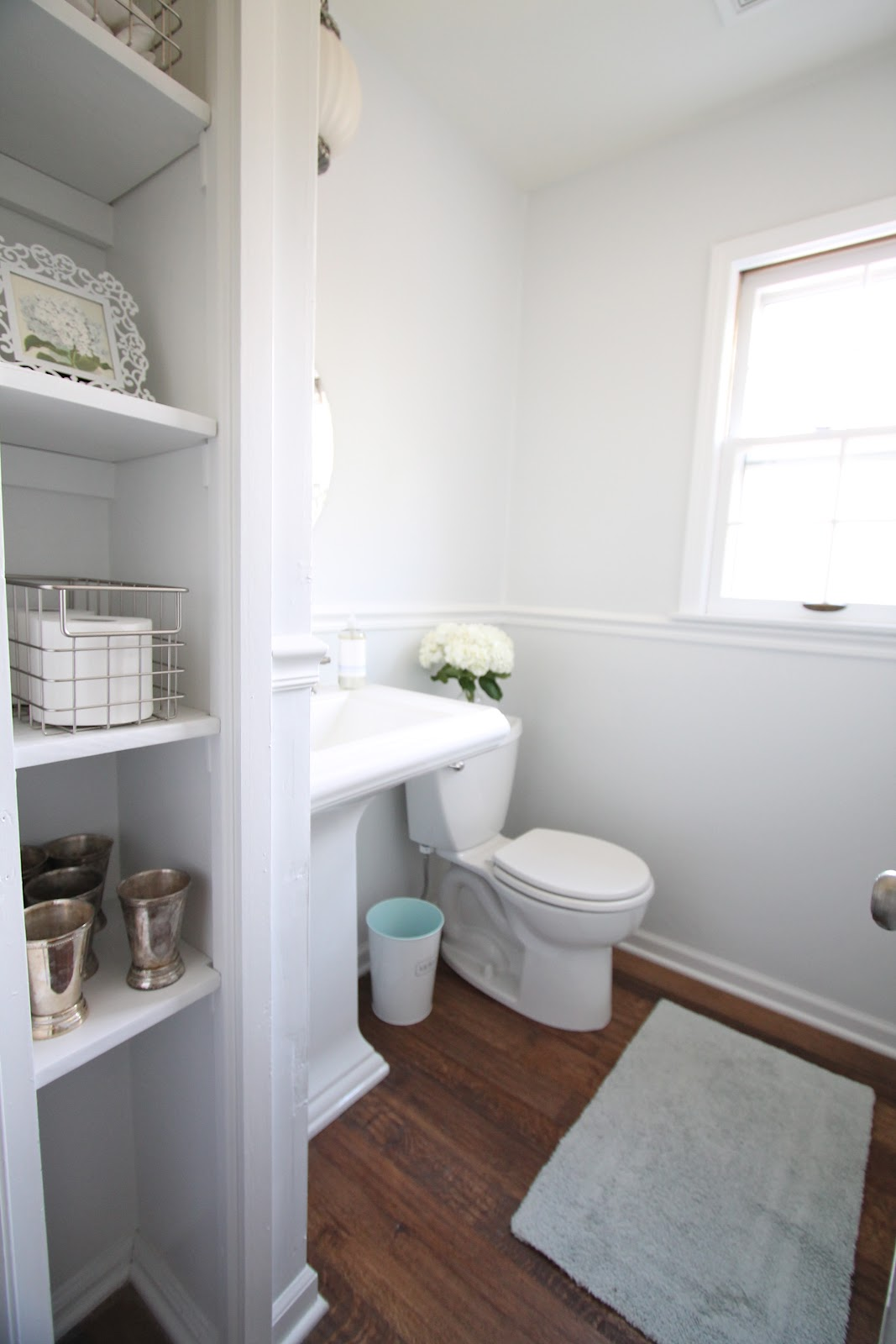 Stunning Design Of The Brown Wooden Floor Ideas Added With White Wall And Grey Rugs Idas With White Sink And Toilets