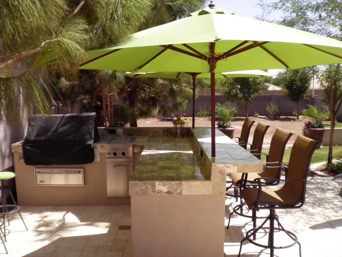 Stunning Design Of The Brown Wooden Seats Added With Green Umbrella Added With Grey Marble Tops As The Backyard Landscape Ideas