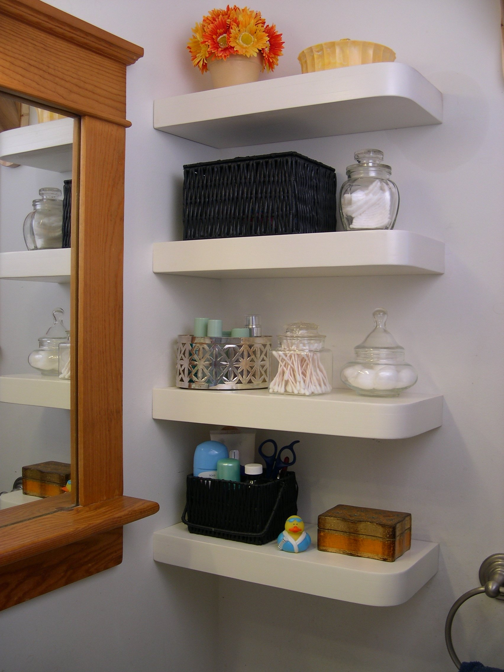 Stunning Design Of The White Silver Corner Floating Shelves Added With Brown Mirror Ideas