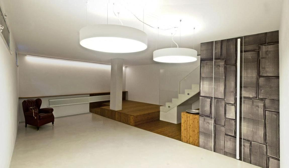 Superb Design Of The Basement Lighting Ideas With White Rounded Ceiling Lamp Ideas Added With White Floor And Grey Fireplace Ideas