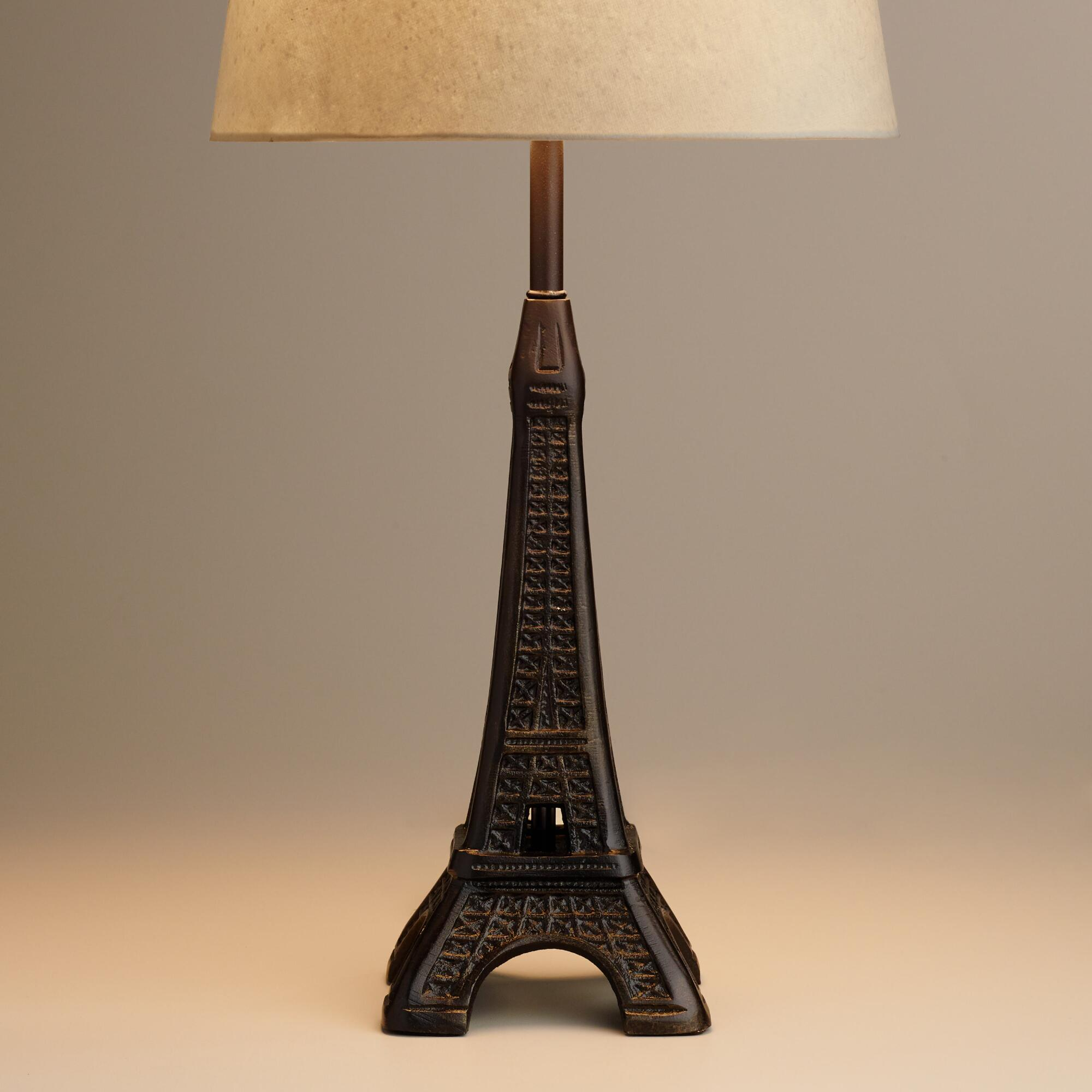 Superb Design Of The Black Iron Eiffel Tower Ideas With Beige Lamp On The White Table Ideas