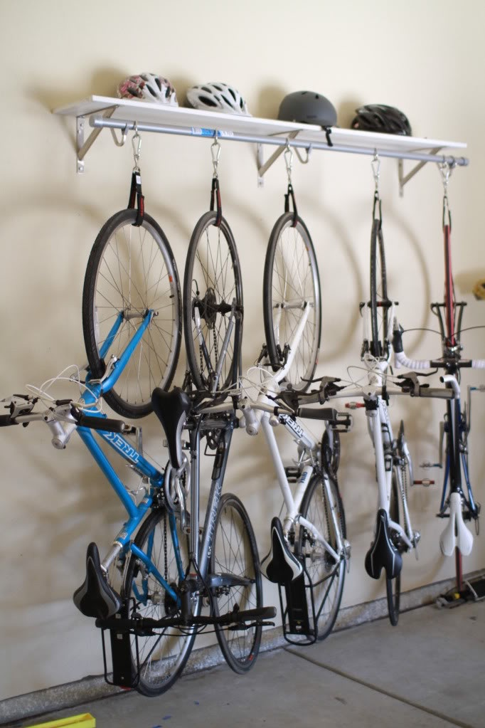 Superb Design Of The Garage Bike Storage With White Shelves With White Wall Ideas And Some Bikes And Helmets