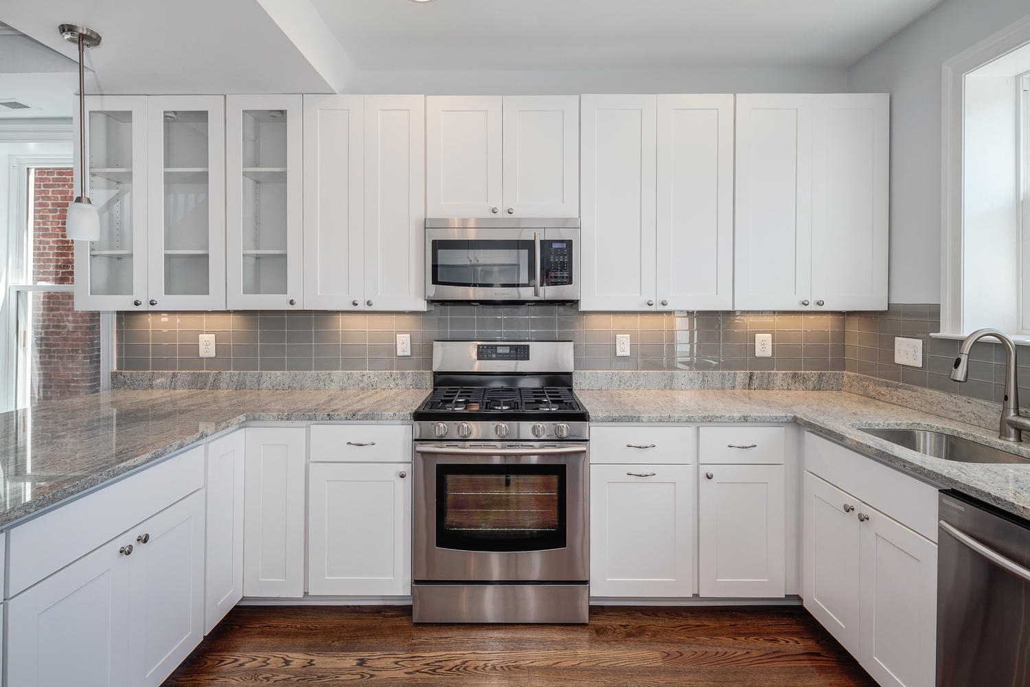 The Simple Kitchens with White Cabinets and Grey Tile Backsplash on Marble Countertop under White Ceiling