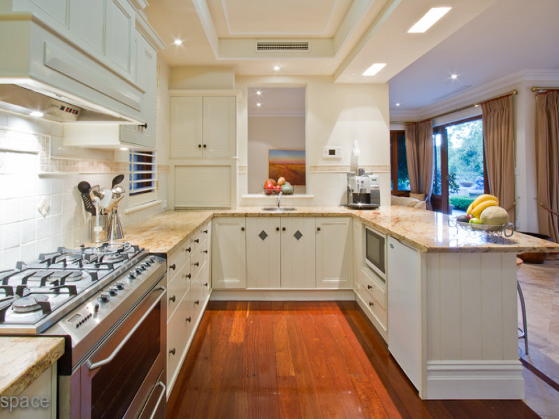 Adorable Design Of The Kitchen Areas With Brown Wooden Floor Ideas Added  With White Cabinets And
