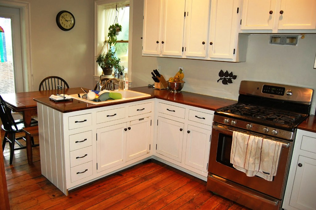 Adorable Design Of The Kitchen Countertop Materials With Brown Wooden Color Added With White Cabinets Ideas