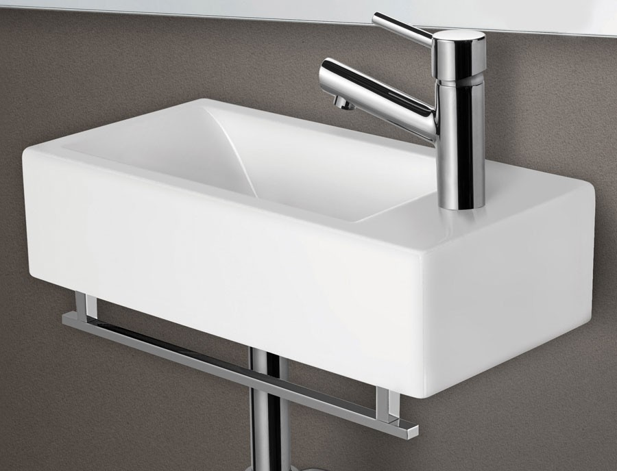 Adorable Design Of The Wall Mounted Sink With White Little Square Shape  Added With Silver Faucets