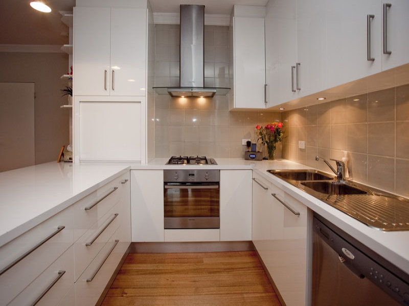 Amazing Design Of The Kitchen Areas With White Wooden Cabinets And Brown Wooden Floor Ideas With Silver Stove Ideas