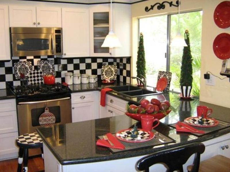Amazing Design Of The Kitchen Decorating Themes With Black Marble Countertops Ideas Added With White Wooden Kitchen Cabinets And Vanities